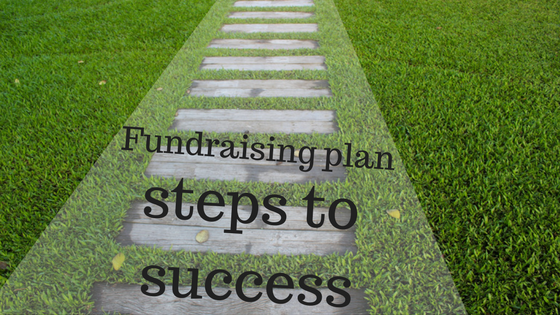 wooden steps on grass with text overlay: Fundraising plan steps to success