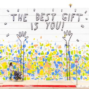 wall with graffiti saying the best gift is you for annual appeal