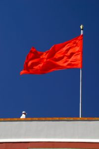 red flag flying on roof for issues around a 3rd party fundraiser