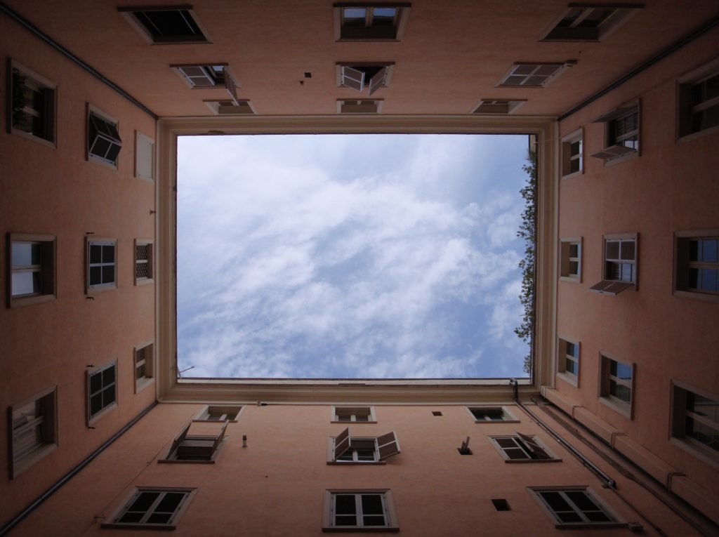 looking at sky up through the middle of 4 walls of a building indicating the power of thought to change your reality