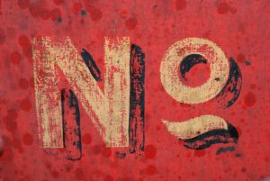 red sign saying No indicating the power of thought when you can't say no