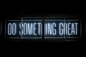 Neon sign saying Do Something Great which is possible when you have self-awareness