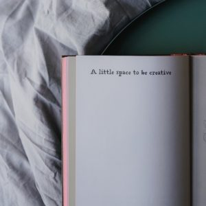 blank book opened to a page that says A little space to be creative