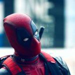 Deadpool costume as symbol of impostor