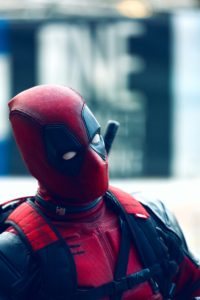 Deadpool costume as symbol of impostor