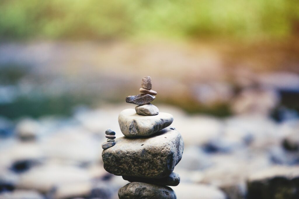 Balancing your priorities to achieve your goals. Rocks on top of each other.