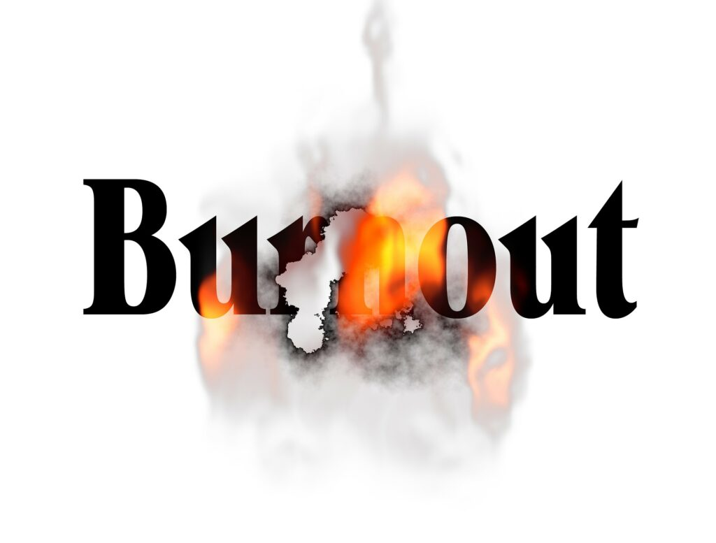 The word Burnout with flames and smoke showing overwhelm